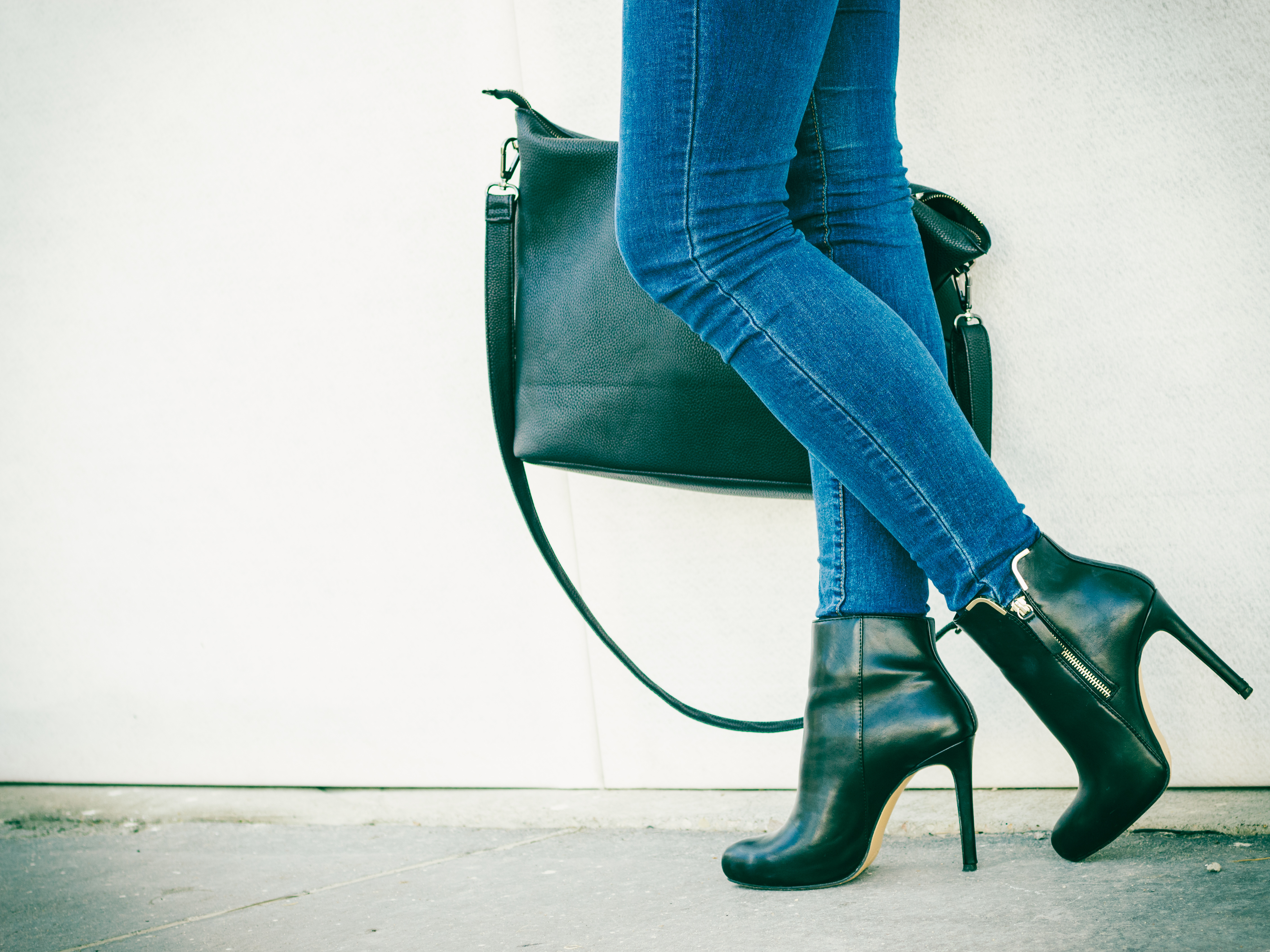 8096c11e3cf22 Autumn fashion outfit. Fashionable woman long legs in denim pants black  stylish high heels shoes